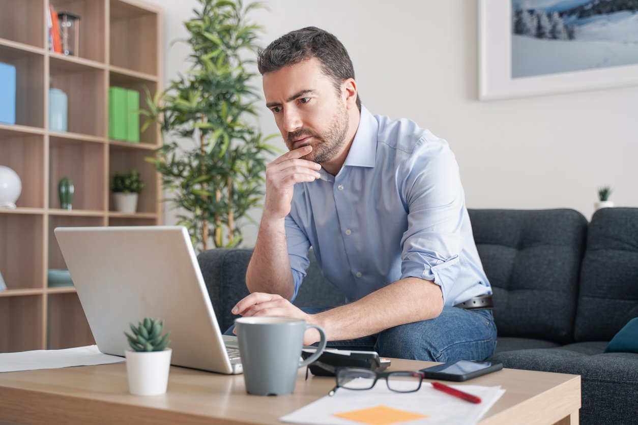 one guy wearing headphones working remotely from home as a digital court reporter